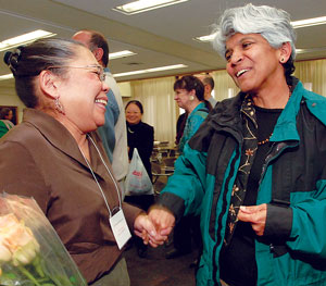 UIC's Woman of the Year Cynthia Jameson (left) is congratulated Friday by Mrinalini Rao