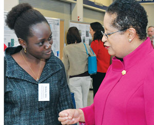 Shirley Ann Jackson, right, chats with Belinda Akpa, assistant professor of chemical engineering