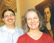 Dan Portincaso and Peg Strobel with a portrait of Jane Addams