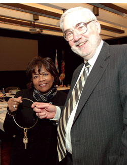 Eric Gislason, interim chancellor, presents Paula Allen-Meares with keys to the campus