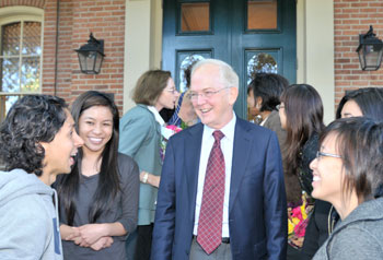 University of Illinois President Michael Hogan chats with students at the museum's reopening.